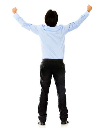 Business man celebrating with arms up - isolated over a white background