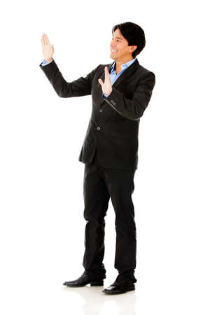 Businessman touching imaginary object with hands - isolated  photo
