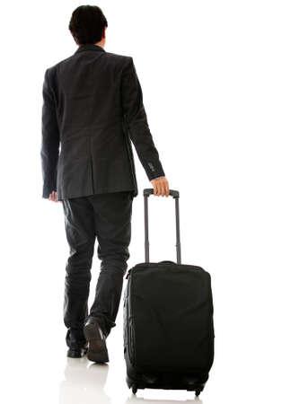 bagage: L'homme part en voyage d'affaires � pied avec sac - isol� Banque d'images