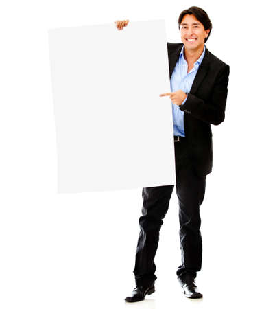 Businessman pointing at a banner - isolated over a white background photo