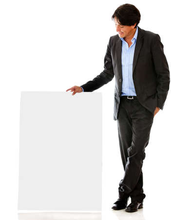 Businessman looking at a banner - isolated over a white backgorund photo