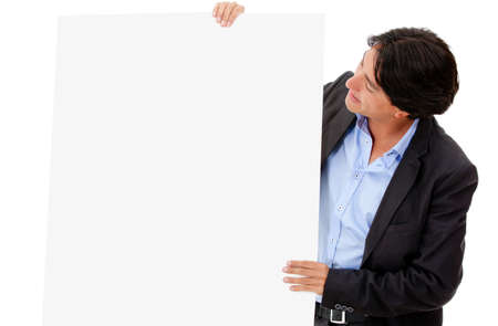 Business man looking at a banner - isolated over a white background  photo