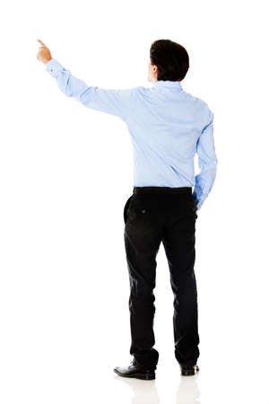 Business man pointing with finger - isolated over a white background photo