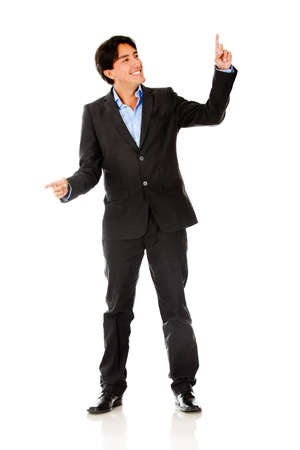 Businessman pointing with two hands - isolated over a white background  photo