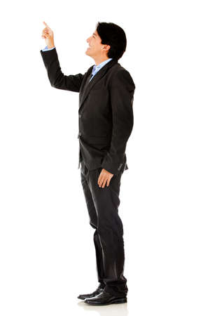 Business man pointing - isolated over a white background photo