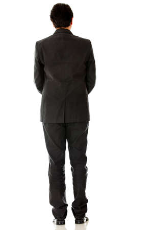 Rear view of a businessman in a suit - isolated over a white background photo