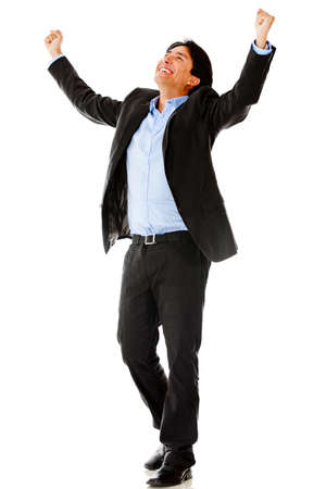 Business man with arms up - isolated over a white background photo