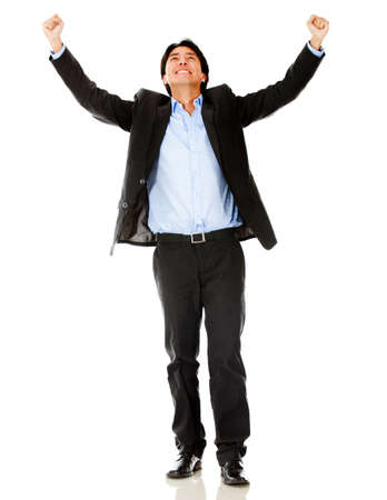 Successful businessman celebrating with arms up - isolated over white  photo