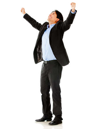 Successful business man with arms up - isolated over a white background Stock Photo - 13135500