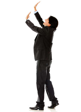 Business man lifting an imaginary object - isolated over a white background photo