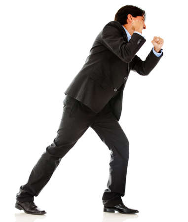 Business man pulling an imaginary rope - isolated over a white background Stock Photo - 13135506