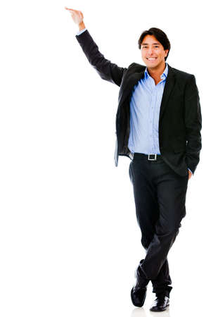 Business man with hand on a tall imaginary object - isolated over white  photo