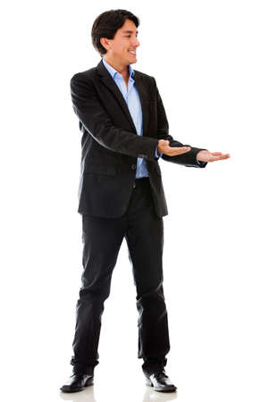 Businessman holding something in his hands - isolated over a white background  photo