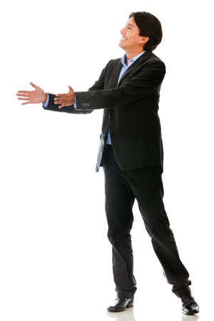 Businessman passing an imaginary object - isolated over a white background photo
