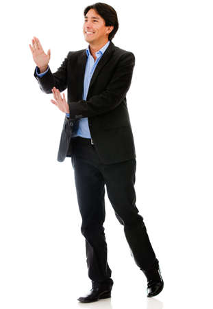 Businessman pushing with his hands - isolated over a white background  photo