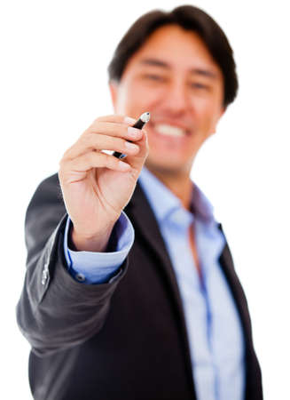 Businessman holding a pen - isolated over a white background photo