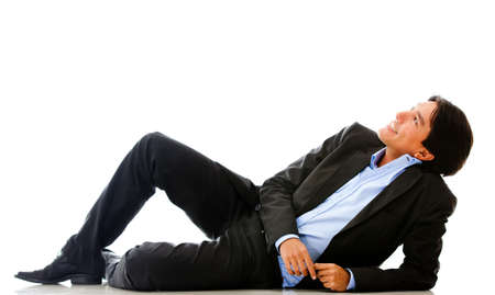 Relaxed businessman day dreaming - isolated over a white background photo