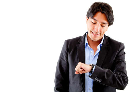 latin look: Businessman checking the time on his watch - isolated ove a hwite background Stock Photo