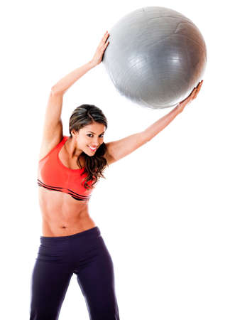 Woman with a pilates ball - isolated over a white background photo