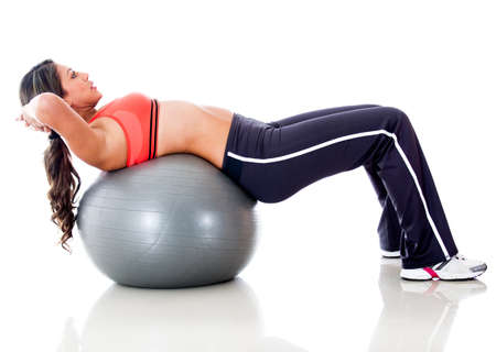 Woman exercising with a  Swiss ball - isolated over a white background photo