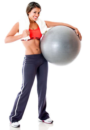Woman with a Swiss ball for Pilates - isolated over white background  photo