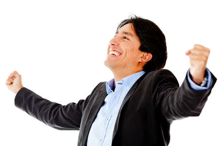 Successful businessman with arms up - isolated over a white background photo