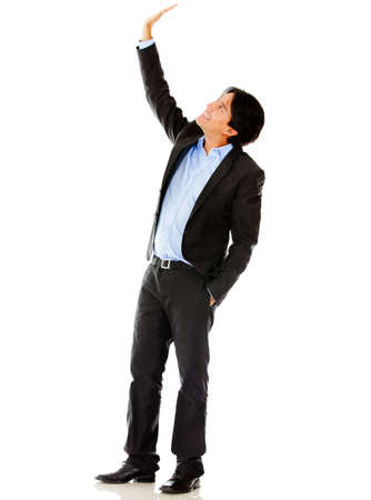 Businessman lifting one arm - isolated over a white background  photo
