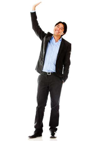 Hombre de negocios levantando la mano - aislados en un fondo blanco photo