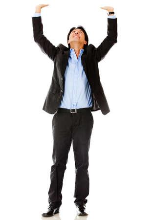 Hombre de negocios levantar un objeto imaginario - aislados en un fondo blanco photo