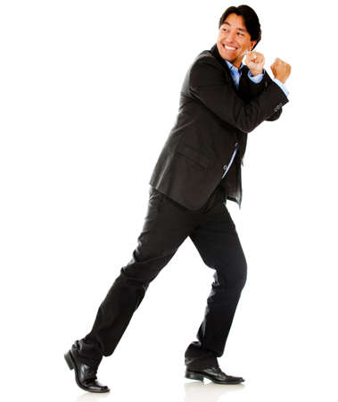 Business man pulling an imaginary rope - isolated over a white background photo