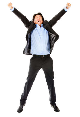 Excited business man jumping - isolate over a white background photo