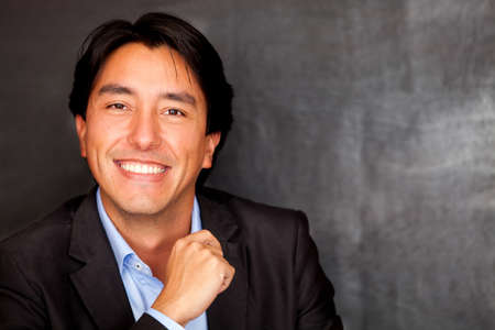 Portrait of a confident Latin man smiling  photo