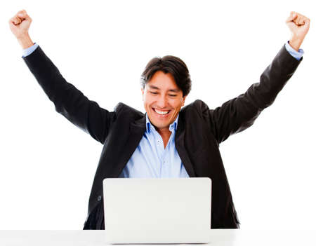 Successful online business man with laptop - isolated over a white background photo