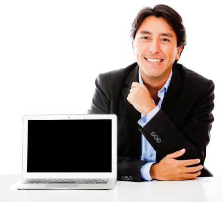 Business man with a laptop - isolated over a white background photo