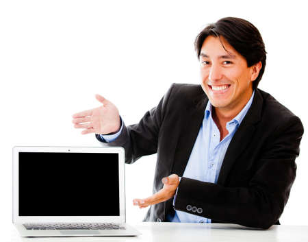 displaying: Business man displaying something in a laptop - isolated over a white background Stock Photo