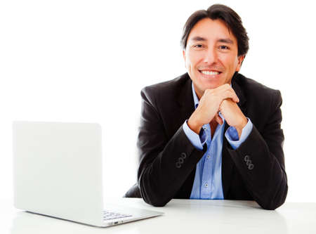 Businessman with a laptop computer - isolated over a white background photo