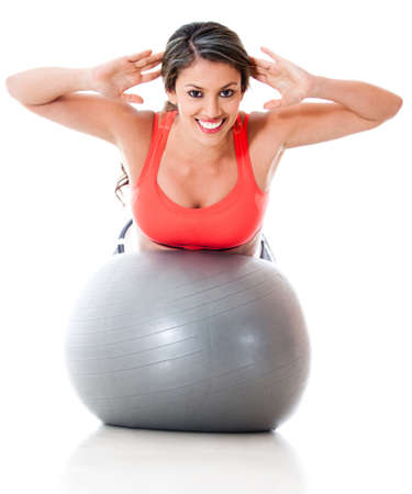 Woman exercising with pilates ball - isolated ove a white background  photo