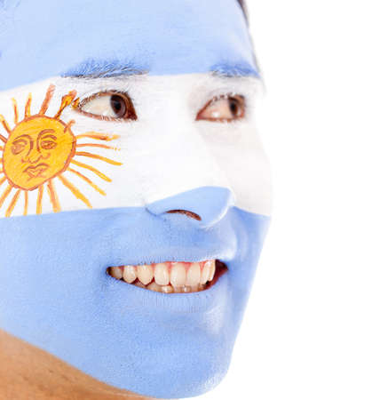 Man with Argentinean flag painted on his face - isolated  photo
