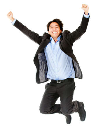 Happy businessman jumping - isolated over a white background photo