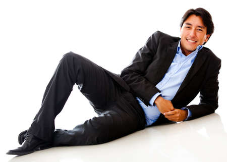lying on floor: Businessman lying on the floor - isolated over a white background