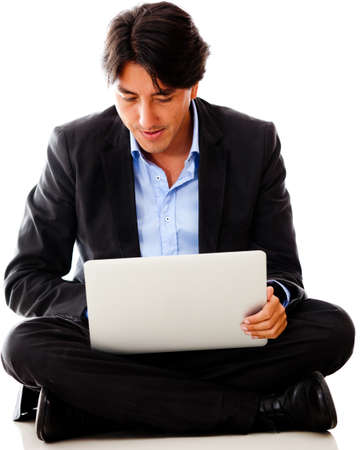Businessman working on a laptop - isolated over a white background photo