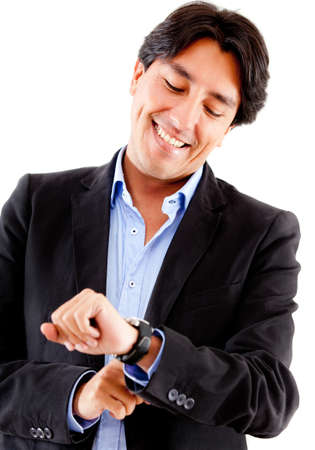 Businessman watching the time on his watch - isolated over a white background photo