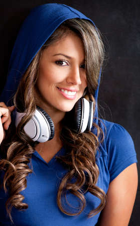 Young woman with headphones listening to music   photo