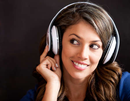 listen to music: Woman portrait listening to music with headphones