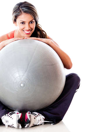 Athletic woman with a Pilates ball - isolated over a white background