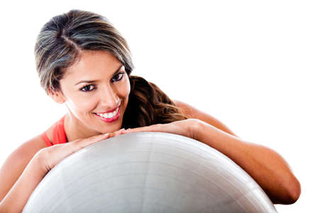 Woman with a Swiss ball - isolated over a white background  photo
