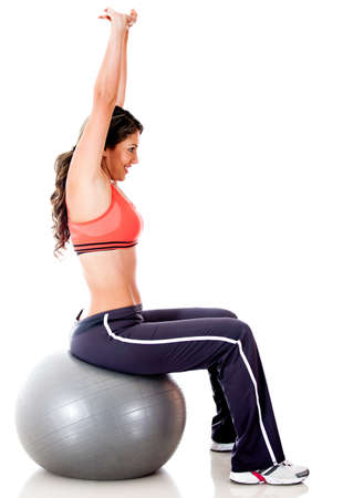 Woman exercising with a Swiss ball - isolated over a white background Stock Photo - 13178546