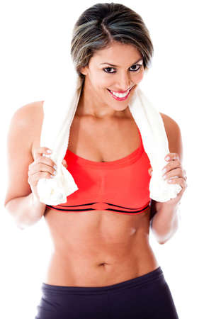 Healthy fit woman smiling and holding a towel - isolated over white  photo