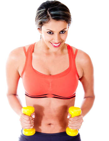 Woman exercising with weights - isolated over a white background  photo