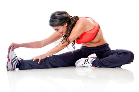 Woman doing stretching exercises - isolated over a white background  photo
